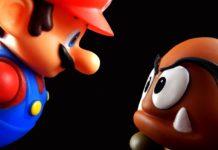 Bilden föreställer en tredimensionell Super Mario och en Gomba-fiende som stirrar på varandra.